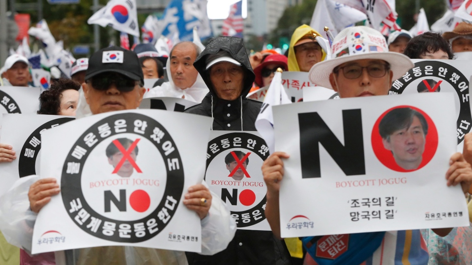 In this Sept. 7, 2019, photo, anti-government protesters stage a rally against President Moon Jae-in's nomination of Cho Kuk as justice minister in Seoul, South Korea. (AP Photo/Ahn Young-joon)