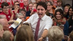 File photo: Liberal Leader Justin Trudeau greets supporters as he makes his way through a crowd at a campaign rally in Winnipeg on Saturday, Oct. 17, 2015. THE CANADIAN PRESS/Paul Chiasson