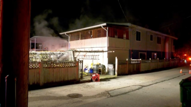 A resident said he was forced to jump from a second floor balcony to escape a fire burning in his East Vancouver home. (Photo: Jordan Jiang/CTV News)