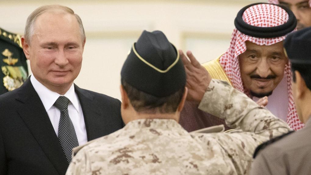 Vladimir Putin, left, and King Salman, right