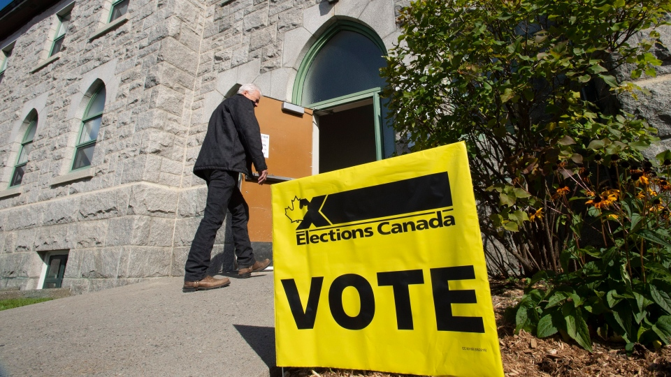 A voter walks in a polling station as the advance vote is opened, Friday, October 11, 2019 in St-Georges Que. THE CANADIAN PRESS/Jacques Boissinot