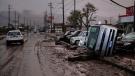 Typhoon-damaged cars sit on the street covered with mud Monday, Oct. 14, 2019, in Hoyasu, Japan. (AP Photo/Jae C. Hong)