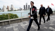 A view of the city of Detroit, provides a backdrop as Liberal leader Justin Trudeau leaves after speaking at an event at St. Clair College in Windsor, Ont., on Monday Oct. 14, 2019. THE CANADIAN PRESS/Sean Kilpatrick