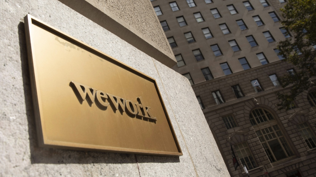 A WeWork sign on a building in New York