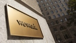 A WeWork sign on a building in New York, seen on Sept. 30, 2019. (Mark Lennihan / AP)