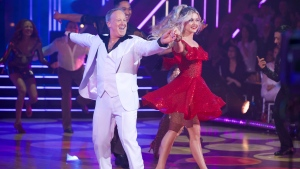This Sept. 30, 2019 photo released by ABC shows former White House press secretary, Sean Spicer, left, and Lindsay Arnold during the celebrity dance competition series 'Dancing With the Stars,' in Los Angeles. (Eric McCandless/ABC via AP)