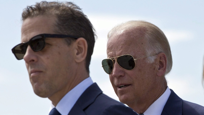 U.S. Vice President Joe Biden, right, and his son Hunter Biden in Sojevo, Kosovo, on Aug. 17, 2016. (Visar Kryeziu / AP)