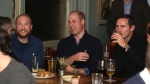 Prince William, Duke of Cambridge, watches with football fans and Chelsea manager Frank Lampard right, after discussing mental health as part of the Heads Up campaign, , as part of the Heads Up campaign, as they watch England play the Czech Republic match in a Euro 2020 qualifying match at a pub in South West London. (Chris Jackson/ PA via AP)