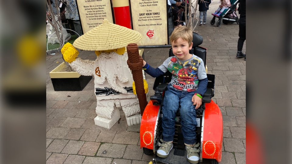 Sebby Brett with a Legoland ninja character at Legoland Windsor Resort in England. (Joanna Brett)