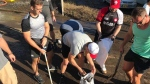 Canadian rugby players assist with cleanup of streets of Kamaishi, Japan, following Typhoon Hagabis