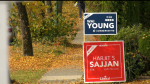 Election signs for Conservative candidate Wai Young and Liberal incumbent Harjit Sajjan in the Vancouver South riding.