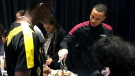 Andre De Grasse is seen giving out food in Toronto on Thanksgiving. (CTV News Toronto / Nick Dixon)