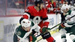 Minnesota Wild left wing Kevin Fiala (22) is checked by Ottawa Senators defenceman Dylan DeMelo (2) during first period NHL hockey action in Ottawa, Monday, Oct. 14, 2019. THE CANADIAN PRESS/Fred Chartrand