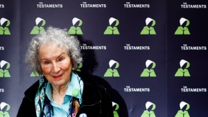 In this Tuesday, Sept. 10, 2019 file photo, Canadian author Margaret Atwood poses for a photograph during a press conference at the British Library to launch her new book 'The Testaments' in London. (AP Photo/Alastair Grant, File)