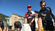 Rugby players help out a typhoon-ravaged area of Japan during the Rugby World Cup. (Twitter/@RugbyWorldCup)