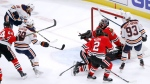 Edmonton Oilers' James Neal (18) scores past Chicago Blackhawks goaltender Corey Crawford during the third period of an NHL hockey game Monday, Oct. 14, 2019, in Chicago. (AP Photo/Charles Rex Arbogast)