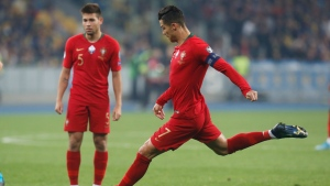 Portugal's Cristiano Ronaldo kicks the ball during the Euro 2020 group B qualifying soccer match between Ukraine and Portugal at the Olympiyskiy stadium in Kyiv, Ukraine, Monday, Oct. 14, 2019. (AP Photo/Efrem Lukatsky)