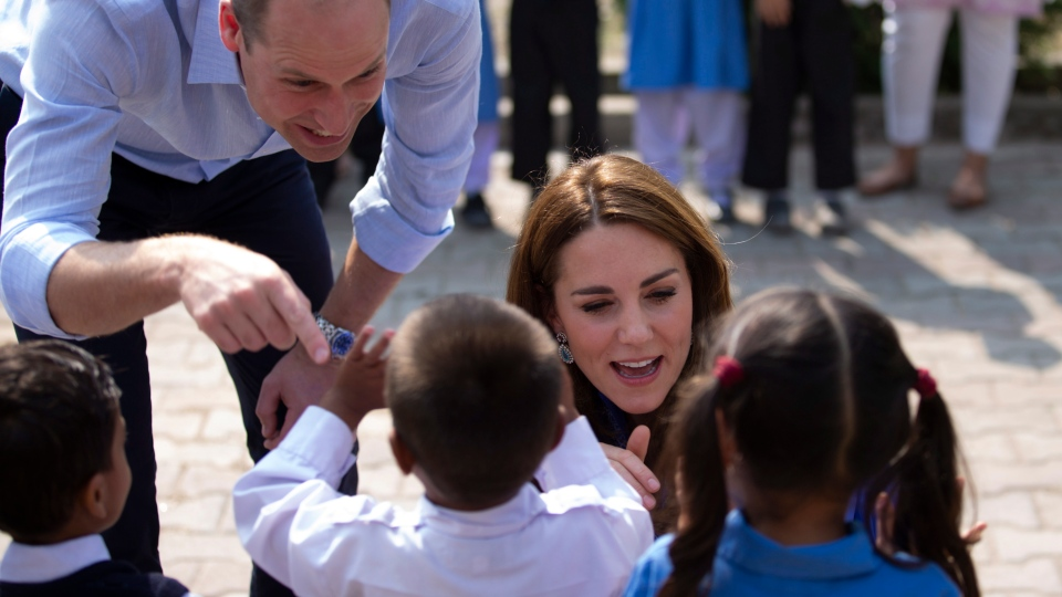 Britain's Prince William and his wife Kate speaks to students during their visit to Islamabad, Pakistan, Tuesday, Oct. 15, 2019. (AP Photo/B.K. Bangash)