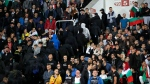 Bulgarian fans leave the stadium during the Euro 2020 group A qualifying soccer match between Bulgaria and England, at the Vasil Levski national stadium, in Sofia, Bulgaria, Monday, Oct. 14, 2019. (AP Photo/Vadim Ghirda)