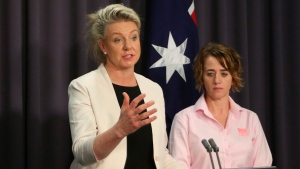 Australian Agriculture Minister Bridget McKenzie, left, and pork industry executive Margo Andrae address the media at Parliament House in Canberra, Australia Tuesday, Oct. 15, 2019, on the threat of African swine fever. (AP Photo/Rod McGuirk)