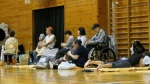 Evacuated residents siting inside a shelter in Tokyo to wait out Typhoon Hagibis. AFP