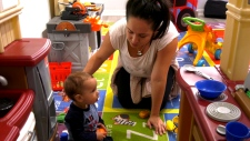 Scarborough-resident Keila Paz plays with her 14-month-old son. (CTV News Toronto / Natalie Johnson)