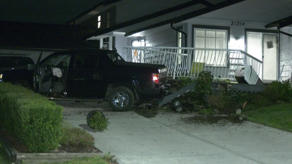 Driver crashes into balcony of Langley home