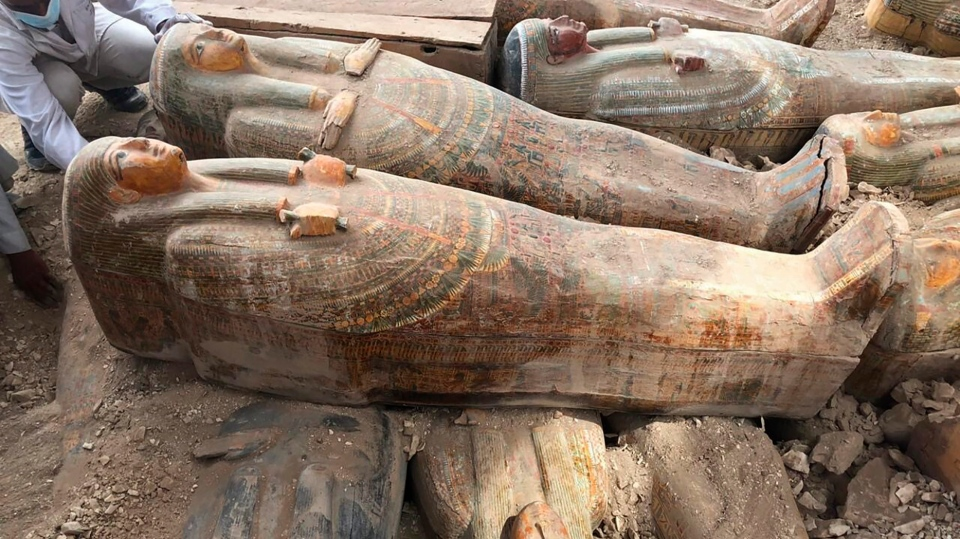 "This photo provided by the Egyptian Ministry of Antiquities shows recently discovered ancient colored coffins with inscriptions and paintings, in the southern city of Luxor, Egypt, Tuesday, Oct. 15, 2019. The ministry said archeologists found at least 20 wooden coffins in the Asasif Necropolis, describing it as one of the ""biggest and most important"" discoveries in recent years. (Egyptian Ministry of Antiquities via AP)"