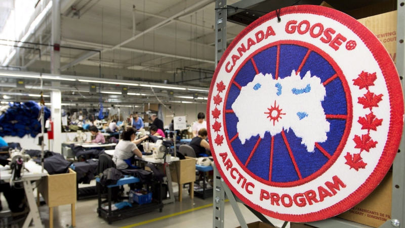 Employees work with Canada Goose jackets at the Canada Goose factory in Toronto on April 2, 2015. THE CANADIAN PRESS/Nathan Denette