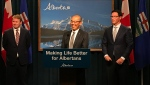 Alberta Health Minister Tyler Shandro, Associate Minister of Health and Addictions Jason Luan and Justice Minister Doug Schweitzer appear at a news conference announcing the lawsuit.
