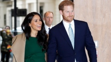 Prince Harry and Meghan, the Duke and Duchess of Sussex arrive to attend the WellChild Awards Ceremony in London, Tuesday, Oct. 15, 2019. (AP Photo/Kirsty Wigglesworth)