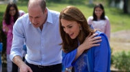 Prince William and his wife Kate speak to students during their visit to a school in Islamabad, Pakistan on Tuesday, Oct. 15, 2019. (AP Photo/B.K. Bangash)