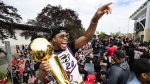 Toronto Raptors guard Kyle Lowry waves to fans holding the Larry O'Brien Championship Trophy during the 2019 Toronto Raptors Championship parade in Toronto on June 17, 2019. THE CANADIAN PRESS/Frank Gunn