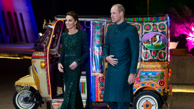 Prince William and his wife Kate arrive in a traditionally painted motorized rickshaw to attend a reception in Islamabad, Pakistan, Tuesday, Oct. 15, 2019. (AP Photo/B.K. Bangash)
