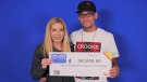 Chrissy Rudderham and Joseph Proulx of Midland hold their winning ticket. (OLG)