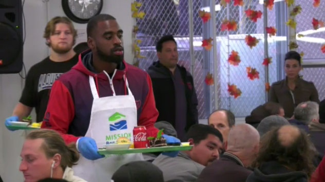 Als players serve up turkey dinner for 400 during annual visit to Welcome Hall Mission