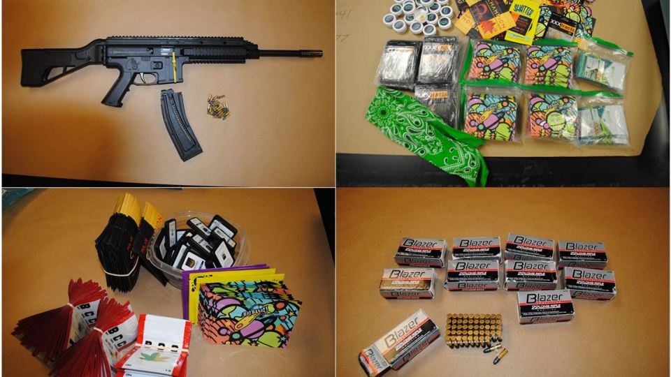 Investigators found a loaded .22 calibre assault rifle, nine boxes of ammunition, 359 packages of cannabis shatter, one ounce of pre-packaged soft cocaine, and more than $4,200 in cash in 22nd Street motel, police say. (Saskatoon Police Service.)