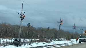 Manitoba Hydro workers making repairs along Highway 239 near Steep Rock Sunday. Source: Karen Price (submitted).