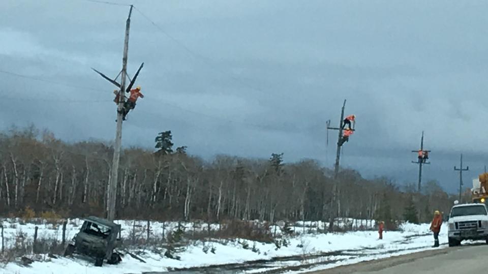 Manitoba Hydro workers making repairs along Highwa