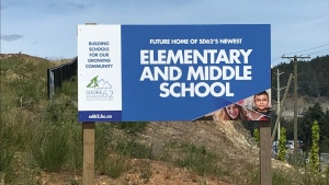 A sign placed at the construction area of a new elementary school and middle school in west Langford. (School District 62/Twitter)