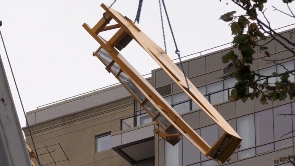 Some Halifax condo residents allowed back home after parts of crane finally removed