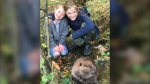 Jennifer Buck's children snap a picture with the rescued beaver. (Photo by Jennifer Buck)