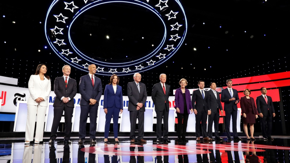 The Democratic presidential candidates stand on stage for a photo before a Democratic presidential primary debate hosted by CNN and The New York Times at Otterbein University, Tuesday, Oct. 15, 2019, in Westerville, Ohio. (AP Photo/Tony Dejak)