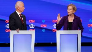 Democratic presidential candidate former Vice President Joe Biden, left, listens as Sen. Elizabeth Warren, D-Mass., speaks during a Democratic presidential primary debate hosted by CNN/New York Times at Otterbein University, Tuesday, Oct. 15, 2019, in Westerville, Ohio. (AP Photo/John Minchillo)