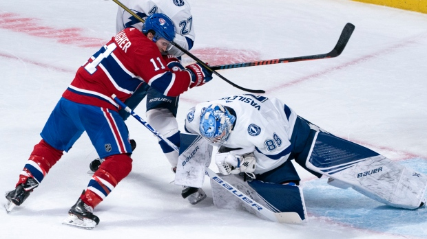 Tampa Bay Lightning goaltender Andrei Vasilevskiy makes a save as Montreal Canadiens' Brendan Gallagher looks for a rebound during second period NHL hockey action in Montreal on Tuesday, Oct. 15, 2019. THE CANADIAN PRESS/Paul Chiasson