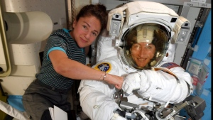 FILE - In this image released Friday, Oct. 4, 2019, by NASA, astronauts Christina Koch, right, and, Jessica Meir pose for a photo on the International Space Station. (NASA via AP)