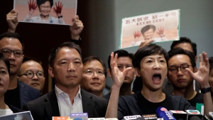 Pan-democratic legislators speak during a press conference after Hong Kong Chief Executive Carrie Lam left the Legislative Council in Hong Kong, Wednesday, Oct. 16, 2019. (AP Photo/Mark Schiefelbein)