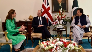 Britain's Prince William, center, and his wife Kate meet Pakistani Prime Minister Imran Khan in Islamabad, Pakistan, Tuesday, Oct. 15, 2019. (AP Photo/Muhammed Ahmed)