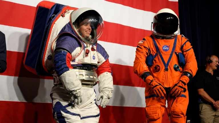 Prototypes of the Orion Crew Survival Suit (R), which will be worn on the way to the Moon, and the Exploration Extravehicular Mobility Unit (xEMU) to be worn on the surface. (AFP)