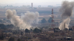 In this photo taken from the Turkish side of the border between Turkey and Syria, in Ceylanpinar, Sanliurfa province, southeastern Turkey, smoke billows from targets in Ras al-Ayn, Syria, caused by bombardment by Turkish forces, Wednesday, Oct. 16, 2019. (AP Photo/Lefteris Pitarakis)